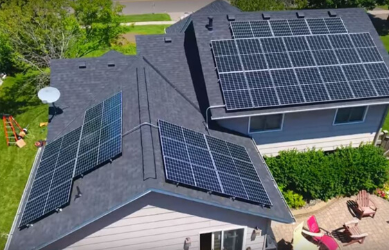 Aerial View Of Solar Panels On Roof Of House