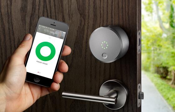 Hang Holding Mobile Phone Showing App Connected To Door Smart Lock