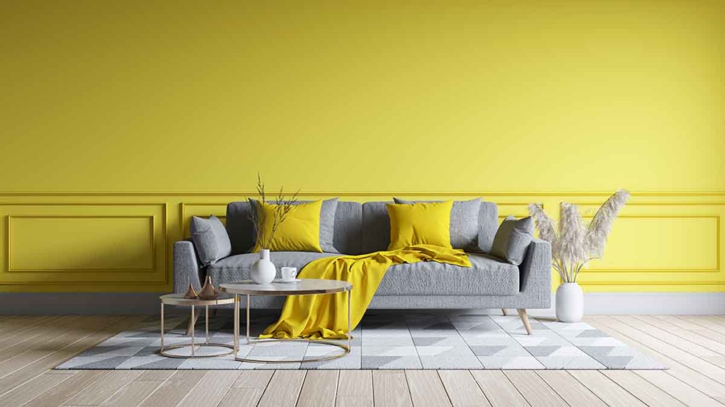 Modern living room interior design. yellow paint wall with yellow sofa . Color of the year 2021